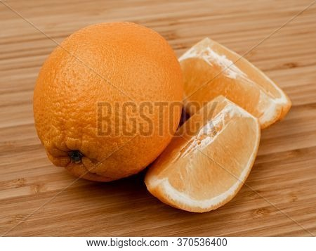 Orange On A Wooden Background. Wooden Plank. Harvest Fresh Oranges. Ripe Fruit. Wood Texture. Orange