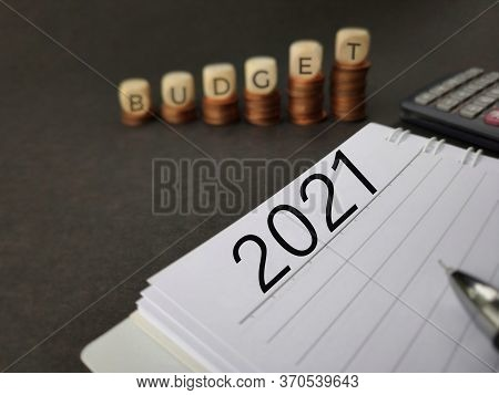 Finance, Business And Economy Concept - 2021 Text Written On Notepad In Vintage Background. Stock Ph