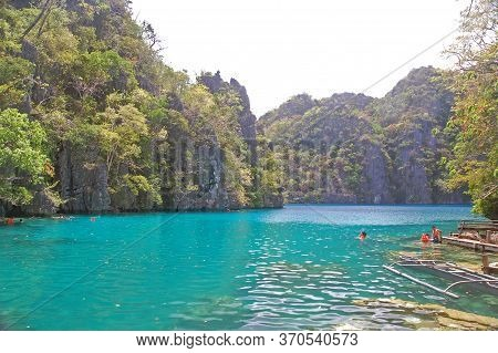 Palawan, Ph - March 7 - Tourists Swimming At Kayangan Lake On March 7, 2012 In Coron, Palawan, Phili