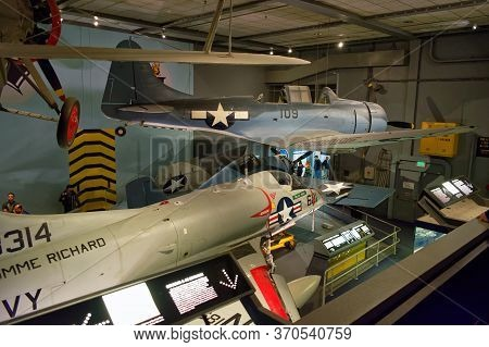 Washington, D.C., USA - November 12, 2017: Visitors looking at various U.S. Navy airplanes in the Naval aviation hall, Smithsonian National Air and Space Museum.