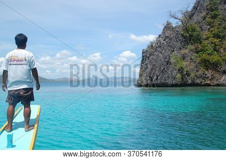 Palawan, Ph - March 7 - Man Standing On Boat At Kayangan Lake On March 7, 2012 In Coron, Palawan, Ph