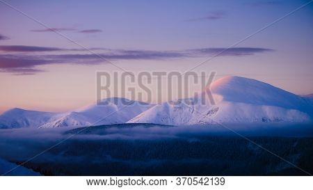 Winter Mountain Range And Goverla Summit Over Morning Sunrise Light, Carpathians, Ukraine