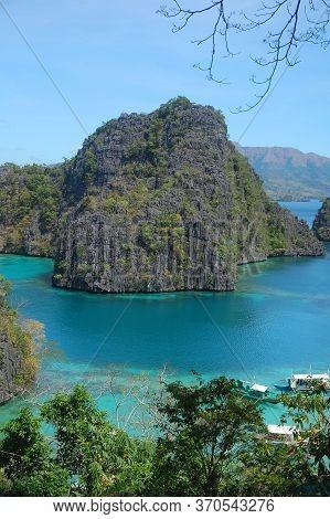 Kayangan Lake Water, Limestone Rock Formation And Sky View In Coron, Palawan, Philippines