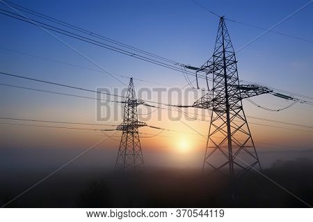 Energy Distribution Network, Transmission Line Pylon, At Sunset.