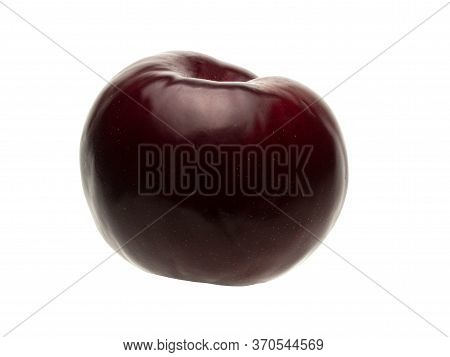 Isolated Object On A White Background. The Shape Of The Plum Fruit Is Round. Ripe Drupe Of Lilac And