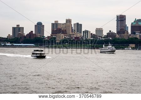 New York, Usa - June 7, 2019:  Tourist Boats On East River In Front Of Manhattan, A East River Ferry