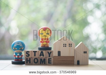 Bangkok, Thailand - June 9, 2020: Superhero With Miniature Wood Home. Concept Of Hero At Home. Conce