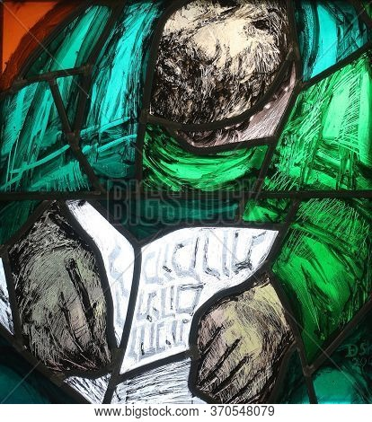 SONTBERGEN, GERMANY - OCTOBER 20, 2014: Isaiah, the journey of the nation at the end of the day on Mount Sinai, detail of stained glass window by Sieger Koder in Saint James church in Sontbergen
