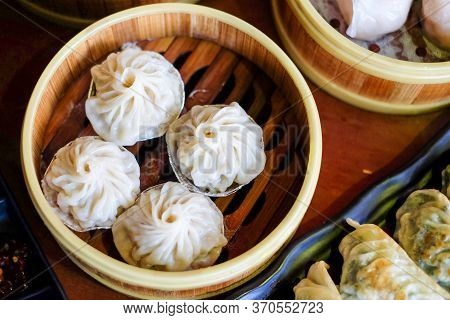 The Hot Xiao Long Pao In Bamboo Steaming Basket - Famous Chinese Food Concept.