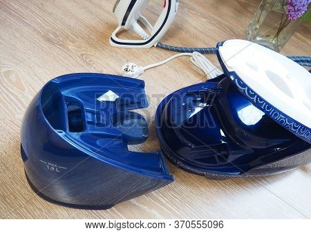 Ironing With An Iron At Home. Steam Generator For Ironing