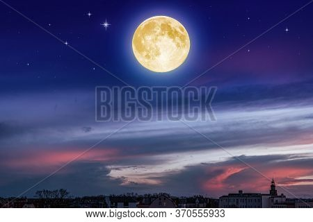 Shined Full Moon . Cloudy Landscape. Night Sky And Bright Moon.