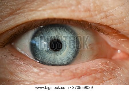Blue Male Human Eye Retina Closeup Super Macro. Laser Correction Vision Concept