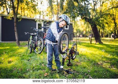 Cyclist Boy Bike Repair. Little Boy Fixing His Bike. Children Mechanics, Bicycle Repair Profession.