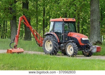 Bauska, June 01: Kioti Tractor Mow Grass In Large Park On June 01, 2020 At Bauska, Latvia. Kioti Tra