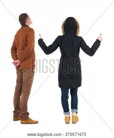 Back view of two young girl in winter jacket showing thumb up. Rear view people collection. backside view of person. beautiful woman friends showing gesture. Rear view. Isolated over white background.