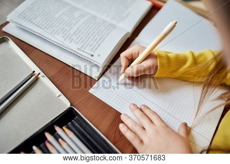 Close Up Of Hands Of Caucasian Little Girl. Kid Is Writing, Learning How To Write Letters Using Pen.