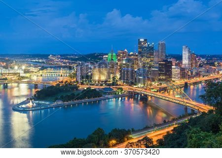 Pittsburgh, Pennsylvania, USA city skyline from the incline at night.