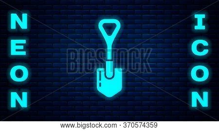 Glowing Neon Shovel Icon Isolated On Brick Wall Background. Gardening Tool. Tool For Horticulture, A