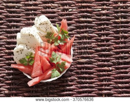 Top View Of A Bowl With Slices Of Sweet Watermelon And Salty Cypriot Halloumi Cheese In Sunlight