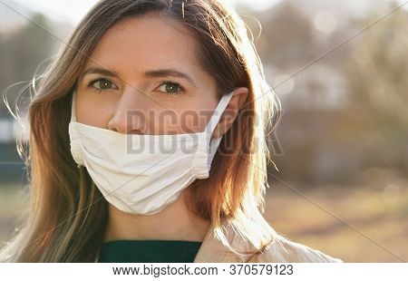 Young Woman Wears Home Made White Cotton Virus Mouth Face Mask, Wrong Way, Incorrect Wearing - Masks