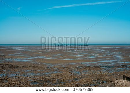 Coast in Whitstable, United Kingdom, showing an Oyster farm on the horizon