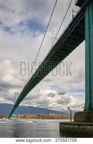 Burrard Inlet Lions Gate Bridge. The Lions Gate Bridge Over The First Narrows Of Burrard Inlet. Nort