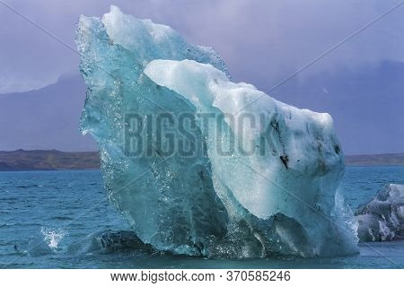 Blue Large Iceberg Diamond Beach Jokulsarlon Glacier Lagoon Vatnajokull National Park Iceland.  Ice