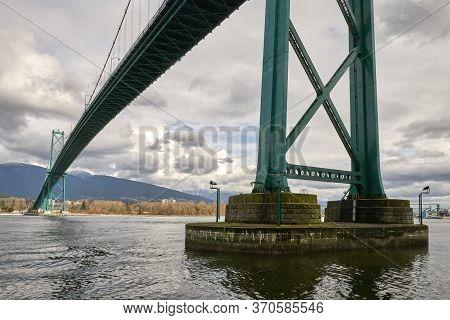 Under Lions Gate Bridge Burrard Inlet. The Lions Gate Bridge Over The First Narrows Of Burrard Inlet