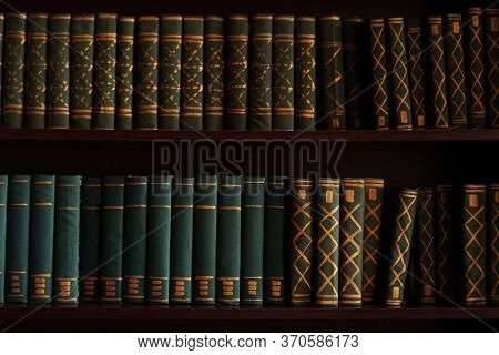 Old Books On An Archival Shelf Of Library Of Storehouse. Two Rows Of Books