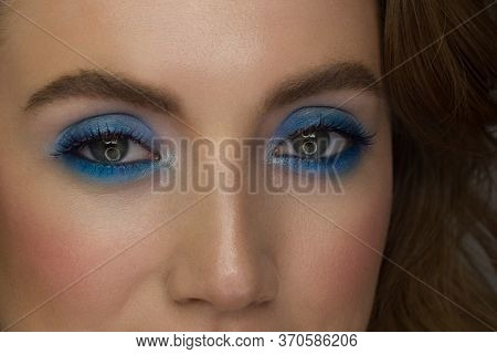 Beautiful Macro Shot Of Female Green Eye With Extreme Long Eyelashes And Smoky Makeup. Perfect Eyebr