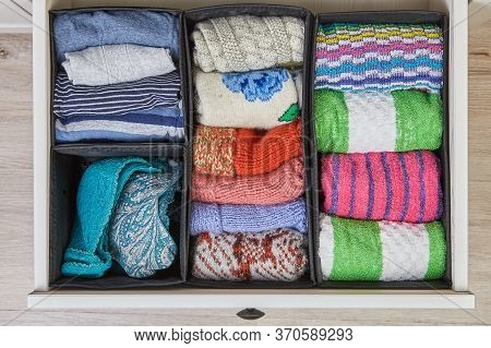 Home Storage System For Linen, Clothes And Fabrics. The Drawer Of The Cabinet Is Divided Into Compar