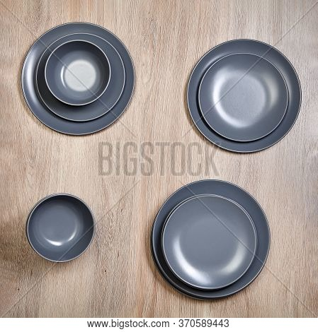 Ceramic Gray Dinnerware, Plates And Bowls. A Set Of Kitchen Utensils For Home Use.