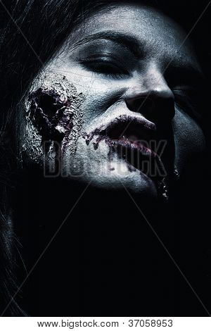 Close-up of a bloodthirsty zombie over black background. poster