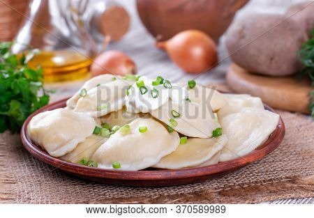 Dumplings, Filled With Mashed Potato In Plate On Wooden Table. Varenyky, Vareniki - Dumplings With F