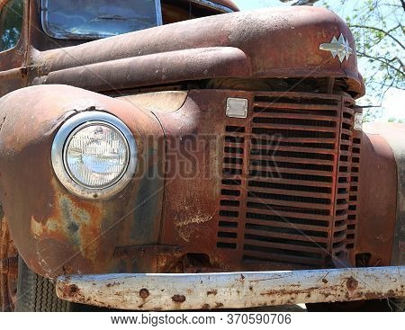 Close-up Detail Of Grill And Headlight Of Antique Truck  - Old And Forgotten Concept