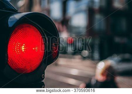 Red Light On Pedestrian Traffic Light In The Street Junction