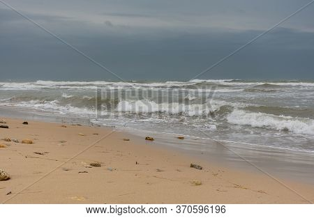 View Of The Stormy Sea Bay With A Sandy Beach. Beautiful Foaming Waves Roll On The Shore. Storm In Y
