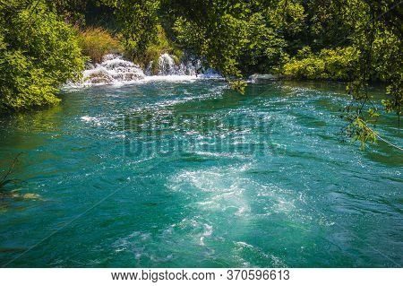 Krka National Park. Waterfall And Wild Landscape At Famous Tourist Attraction In Croatia