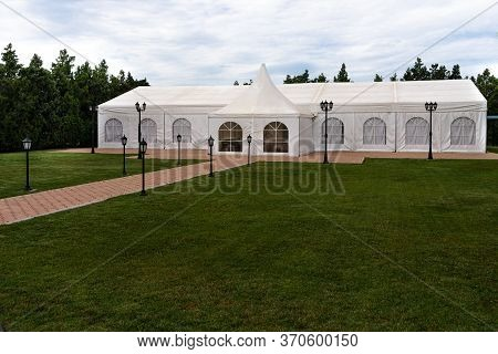 White Tent For Weddings And Celebrations With Trees In The Background