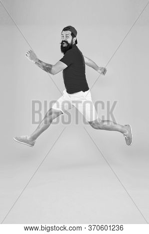 Always In Motion. Enjoying Active Lifestyle. Happy Guy Jumping. Active Bearded Man In Motion Yellow