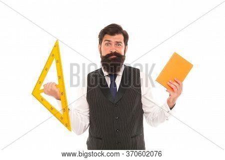 Make Geometry Interesting. School Teacher Hold Book And Triangle. Private Teaching. Bearded Man Prep