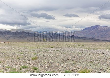 Dry Mongolian Landscapes In The Altai Mountains, Wide Landscape. Rocks Hill In Steppe Of Mongolia