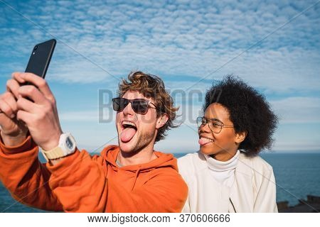 Two Friends Taking A Selfie With Smartpone.