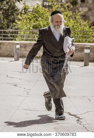 Jerusalem, Israel - 2019-04-26 - Orthodox Jew Walks Across Courtyard.