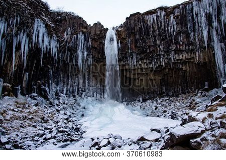 Svartifoss Waterfall Surrounded By Basalt Columns In The South Of Iceland. It Is Surrounded By Dark