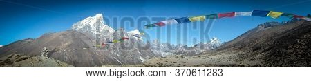 Panoramic Scene In Everest Base Camp Trek. Beautiful View. Prayers Flags Copy Space