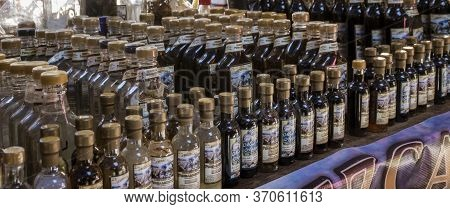 Oaxaca, Mexico - 2019-11-30 - Mezcal Is Lined Up In Liquor Booth In Market.