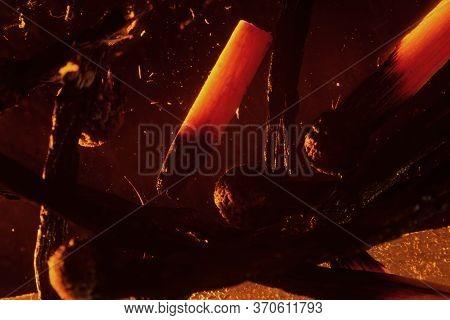 Matchstick Coals Burn On A Dark Background. Close Up Copy Space