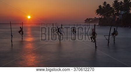 Galle, Sri Lanka - 2019-04-01 - Sstilt Fishermen Of Sri Lanka Spend All Day On Small Platforms To Ca