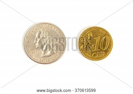 A Quarter Dollar And Dime On A White Background. Isolate. To Close